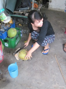 Preparing young coconut water during one of our breaks.
